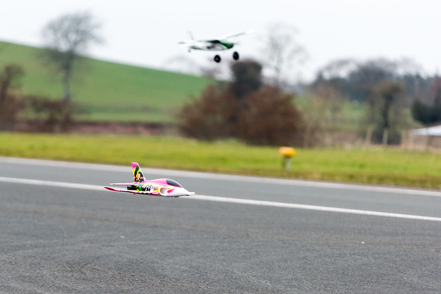Phil doing very low passes with the Stinger MK2 with Nathan and his Tundra in the background..