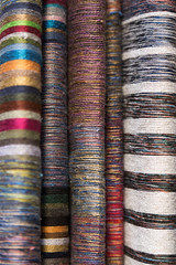 hand woven fabrics in the medina of Fes (noor.khan.alam) Tags: africa travel wool colors factory silk morocco fabric destination woven textiles striped fes threads handwoven
