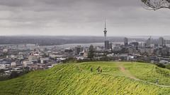 Maungawhau (ZeroOne) Tags: newzealand green clouds landscape volcano cityscape cloudy outdoor auckland crater skytower mounteden aucklandcbd maungawhau scoriacone epl3