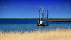 Waterland - local fisherman (Boudewijn Vermeulen) Tags: blue green water grass clouds landscape bomen groen blauw skies meadows wolken gras landschap waterland luchten sloten ditches publ