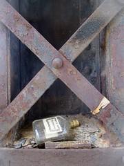 abridged (TMQ.st.louis) Tags: bridge trash bottle rust decay litter liquor cognac corrosion hennessy