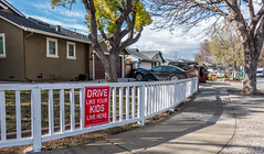 Happy Sign Sunday (randyherring) Tags: california ca street blue trees red sky white house plant green car sign clouds fence us afternoon unitedstates outdoor sanjose sidewalk suburbanstreet