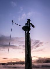 Ringing in the morning (lizcaldwell72) Tags: light newzealand sky mist sunrise hawkesbay churchbell laketutira laketutiramemorialchurch