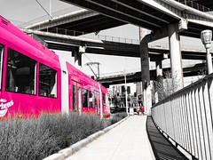Big Pink Streetcars (TMimages PDX) Tags: road street city people urban monochrome buildings portland geotagged photography photo image streetphotography overpass streetscene sidewalk photograph infrastructure pedestrians pacificnorthwest streetcar avenue fineartphotography iphoneography