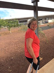 A Windy Welcome at Baltra Airport (Judy O'Connor) Tags: cruise holiday expedition smiling walking happy windy galapagos adventure lindblad judy excitement lookingback nationalgeographic equador galapagosislands baltra baltraairport lindbladnationalgeographic