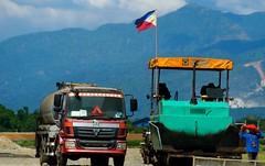 TPLEX - Binalonan, Pangasinan, Philippines (Calantes) Tags: construction flag trucks philippineflag tplex binalonan olympusomdem5