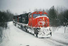 Snowy Junction (view2share) Tags: railroad travel trees winter snow cold mi cn train track december michigan transport tracks engine rail railway rr trains roadtrip transportation rails locomotive snowfall upperpeninsula 2008 ore freight northwood railroaders railroads northwoods canadiannational ironore freighttrain uppermichigan railroading emd northernmichigan ironrange marquettecounty negaunee rring trackage electromotivedivision sd75i december2008 december262008 ironorepellets marquetterange marquetteironrange oreline orepellets empirejunction empirejct cn5778 deansauvola