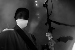 Guiterrorist. (df-stop.) Tags: blackandwhite music man art tattoo night photoshop canon lights back punk mask live smoke mashup front greece microphone thessaloniki sillouette stigma guitarist timeless 8ball macedonian makedonia  macedoniagreece dfstop