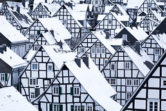 Half Timbered Houses in Winter Dress (Constantin Fellermann) Tags: houses winter blackandwhite white snow black cold geometric germany village half nrw nordrheinwestfalen timbered