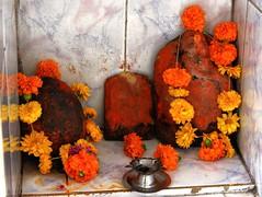 Godly trio (Shrimaitreya) Tags: flowers india ganesha shrine indian garland altar ganesh maharashtra hindu hinduism pune ganapati bharat waysideshrine streetshrine