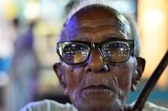 Manab [Stranger # 08 / 100] (s) Tags: portrait india 50mm headshot holi kolkata bengal calcutta streetshot kalighat 100strangers manab nikond7000 kalighatkalitemple thehumanfamily