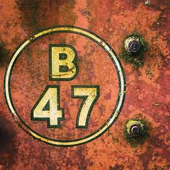 B47 (CarlH55) Tags: red circle rust farm machine bolts agriculture b47