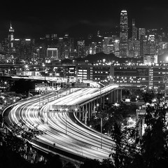 Highway to the City (Wilson Au | ) Tags: city longexposure light blackandwhite monochrome night canon buildings hongkong 11 slowshutter lighttrails  route3 ef70200mmf4lisusm  eos5dmarkiii