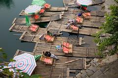 Resting on Yulong river (botterli) Tags: china travel sleeping water umbrella river yulong waiting asia yangshuo bamboo raft resting ricohgr guangxi