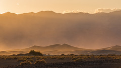 Sunset Sandstorm in Death Valley (Jeffrey Sullivan) Tags: california road park trip travel sunset copyright usa jeff weather canon landscape photography death photo nationalpark sand colorful flat wind dunes windy national mesquite valley sandstorm april deathvalley sullivan dust duststorm sanddunes eureka allrightsreserved 2016 eurekadunes haboob