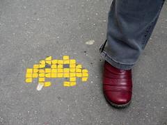 PA_117 Space invader on the pavement (Sokleine) Tags: street streetart paris france yellow jaune foot shoe ceramics spaceinvader mosaics urbanart tiles invader pied mosaque artderue chaussure 75011