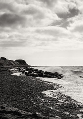 Beach (johanbe) Tags: ocean sea blackandwhite beach monochrome strand denmark nikon rocks wave splash nikkor danmark hav stenar gedser klippor blsigt