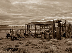 Old Schellbourne Station (http://fineartamerica.com/profiles/robert-bales.ht) Tags: old people mountains ford monochrome beautiful sepia vintage spectacular landscape photo junk desert antique awesome nevada rustic scenic rusty surreal peaceful places super retro nostalgia chrome transportation western vehicle sensational headlight states grille chassis windshield oldcar sublime buldings magnificent rollinghills collector modelt classictruck desertlandscape ponyexpress haybales scenicphotography oldcarandetc robertbales oldpickupoldtruck oldcollectable schellbouonestation