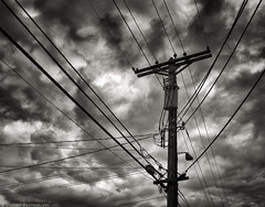Threatening Clouds (mjardeen) Tags: blackandwhite bw white storm black texture clouds contrast 35mm ir outside washington intense wire alley pattern conversion minolta telephone utility pole cables infrared wa converted tacoma f18 a7ii 720nm lifepixel rokkorx a7m2 ilce7m2