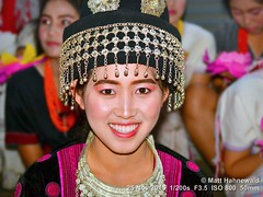 2015-12a Yi Peng I (09) (Matt Hahnewald) Tags: portrait travel festival teeth costume performer ethnic makeup photo headdress posing pretty handsome lips cheerful beauty beautiful consent street cultural hat eyes traditional asia flash matthahnewaldphotography face facingtheworld chiangmai head maechaem miao night nikond3100 southeastasia thai hilltribe smiling yipeng adult nikonsb400 northern headshot nikkorafs50mmf18g fullfaceview 4x3ratio 1200x900pixels resized lookingatcamera colour colourful