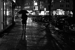 A Walk in the Rain (Jonas Rathgeber) Tags: rain umbrella germany hamburg streetphotography eimsbttel
