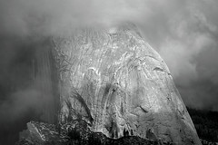 Veiled: Half Dome in Clouds (B&W) (Life_After_Death - Shannon Day) Tags: life california park blackandwhite bw white mist mountain black mountains art history nature monochrome rock misty clouds canon wonder landscape outdoors photography eos death mono evening blackwhite nationalpark day veil view purple natural outdoor nevada grand sierra shannon chrome national yosemite dome half granite halfdome shroud historical after yosemitenationalpark dslr eastern canondslr canoneos majesty sierranevadamountains lifeafterdeath 50d shannonday canoneos50d eosdslr canoneos50ddslr lifeafterdeathstudios lifeafterdeathphotography shannondayphotography shannondaylifeafterdeath lifeafterdeathstudiosartandphotography shannondayartandphotography