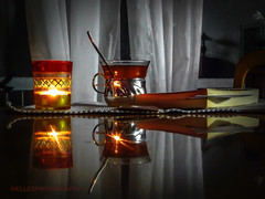 an interesting book and a cup of hot tee (Fay2603) Tags: light red white black reflection cup table book candle curtain teaspoon cupoftee