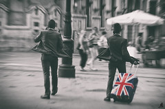 Managers (Alessandro Giorgi Art Photography) Tags: street city uk two people urban motion color colors walking flow movement nikon couple colore outdoor walk flag move luggage persone busy colored movimento manager miscellaneous unionjack due owner citt coppia selective managers bandiera valigia direttore colorato selettivo responsabile d7000 impegnati cammirare