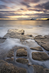 Crazy Paving, Old Hartley (Kathy ~ FineArt-Landscapes) Tags: longexposure greatbritain morning travel light sea england sky lighthouse seascape nature water clouds sunrise landscape dawn coast movement rocks waves mood unitedkingdom britain tide fineart perspective northumberland dreamy tones northeast atmospheric stmarys whitleybay oldhartley