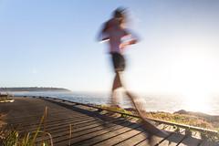Speed of light (Halans) Tags: morning sea sun blur speed sunrise movement ghost running run boardwalk runners speedoflight curlcurl movetheworld
