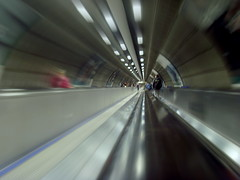 Zooming down the underground in London (Tony Worrall Foto) Tags: county city uk greatbritain travel england people london english metal speed work silver underground subway stream tour open place zoom candid south country capital escalator under tube fast visit move location tourist southern commute area southeast update thetube attraction