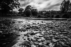 Shapes & Sizes (dolbinator1000) Tags: park uk bridge trees summer bw cloud white black tree water rock stone wales clouds silver river grey big rocks long exposure noir cloudy stones rocky bn stop national nd stony brecon beacons grad blanc stopper powys blancetnoir crickhowell
