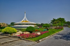 Rajamangala hall and flowers in Suan Luang Rama IX park in Bangkok, Thailand (UweBKK ( 77 on )) Tags: park flowers trees lake building architecture garden thailand hall asia bangkok sony 9 southeast alpha dslr bushes 77 rama slt ix luang suan rajamangala