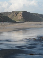 Coal promenade (Nekoglyph) Tags: people black beach wet grass silver reflections seaside sand yorkshire cleveland cliffs promenade saltburn seacoal