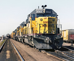 Union Pacific EMD SD40-2 diesel electric locomotive # 8065, in lead of four other loco's, is seen while in charge of a manifest freight train in Colorado, Summer 1980 - 2 (alcomike43) Tags: old classic up vintage ties switch colorado tracks photographers tie trains historic passengers engines rails unionpacific gondola plates freighttrains boxcar spikes engineer steamengine locomotives observers railroads ballast rightofway dieselengine steamlocomotive turnout mainline emd sd402 freightcars passengertrains roadbed diesellocomotive railfans 8065 diesels 8444 dieselelectriclocomotive switchstand anglebars conventionaljointedsectionrail manifestfreighttrains railfanexcursiontrains
