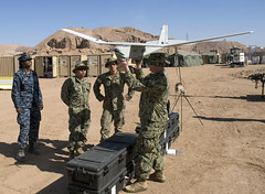 Sailor demonstrates how to use the Aqua Puma unmanned aircraft system during IMCMEX 16. (Official U.S. Navy Imagery) Tags: navy jo jordan expeditionary ctf56 imcmex