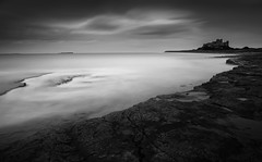 Bamburgh Castle (Billy Currie) Tags: ocean sea england castle beach rock long exposure fort north ruin medieval northumberland coastline bamburgh fortress