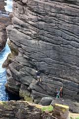 Starting to climb the Old Man of Stoer (milnefaefife) Tags: sea people seascape landscape coast scotland highlands rocks cliffs hills shore ropes moor sutherland rockclimbers climbers moorland seastack stoer assynt northwesthighlands oldmanofstoer pointofstoer stoerhead