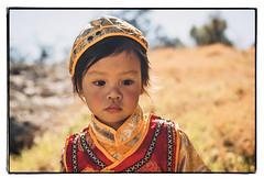 Happy Lunar New Year to all. (TANKSEGUNDO) Tags: red portrait yellow children child newyears tet lunarnewyears