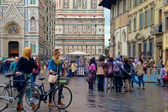 A Rainy Afternoon in Florence (Herculeus.) Tags: road people italy bike landscape religious women outdoor oct churches bikes christian bicycles commercial plazas vehicle firenze 5photosaday 2013 architectureinpixels cathedralofsantamariadelfiorefirenze