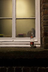Red red kola (Lucky Poet) Tags: window glass night scotland bottle edinburgh empty oldtown windowsill redkola bailiefyfesclose
