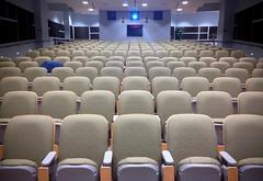 empty auditorium (Mr.  Mark) Tags: blue light green lines work photo focus pattern chairs geometry empty stock repetition presentation orientation auditorium markboucher