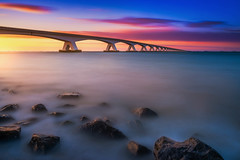Endless (albert dros) Tags: sunset seascape netherlands dutch sunrise rocks seascapes bridges zeeland endless zeelandbrug albertdros
