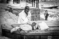 Lunch break (karmajigme) Tags: travel blackandwhite india man monochrome religious nikon noiretblanc streetphotography holy human varanasi pilgrim