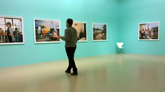 What are you looking at? [EXPLORE 2016-03-04] (pix-4-2-day) Tags: martinparr gallery museum galerie türkis fotos fotografien ausstellung exhibition man mann betrachter frau blick look woman chair stuhl ecke corner turquoise white weis room raum pix42day explore explored