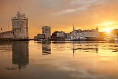 La Rochelle (AdrienC.) Tags: sunset sky sun mer seascape france reflection colors saint lanterne port landscape la soleil tour ciel maritime nicolas nuages paysage reflexion charente vieux chaine rochelle mare
