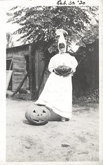 Person in a Halloween costume with two jack-o-lanterns (oakenroad) Tags: old white black halloween monochrome vintage found outside blackwhite costume jackolantern antique snapshot creepy photograph vernacular foundphotograph
