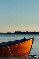 Wooden boat docked by a lake (gabster_ro) Tags: ocean wood travel blue sunset sea summer vacation sky lake holiday nature vertical vintage landscape outdoors bay boat wooden dock marine waterfront jetty floating peaceful vessel calm maritime boating sail serene nautical copyspace tethered tranquil dinghy