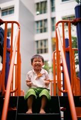 (Edgedale) Tags: playground children 50mm fujifilm elijah olympusom1 asa200