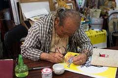 A craft master (fRawnco) Tags: lens japanese 50mm prime nikon artist quotes kanji writer okinawa fx motivational scribes d810